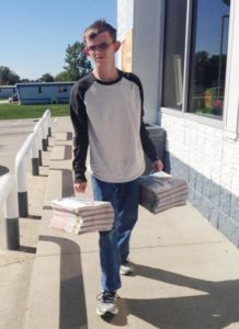 Tim delivers newspapers for The People's Tribune